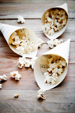 bowl of popcorn: Pop corn in paper cones made from music sheets