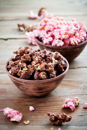 bowls of popcorn: Chocolate pop corn in brown and pink