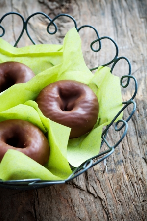 Chocolate donuts wrapped in thin green paper Stock Photo - 19015528