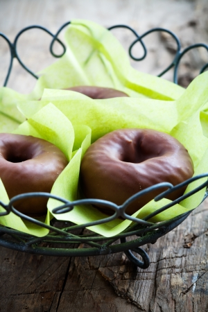 Chocolate donuts wrapped in thin green paper Stock Photo - 19015523