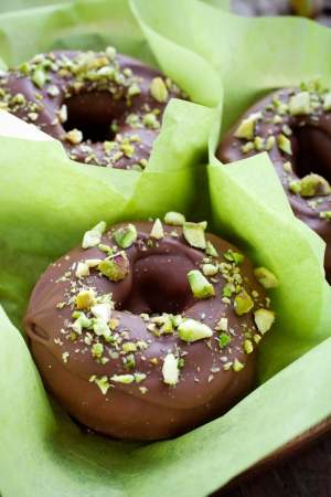 Chocolate donuts with crushed pistachios on top Stock Photo - 19015519