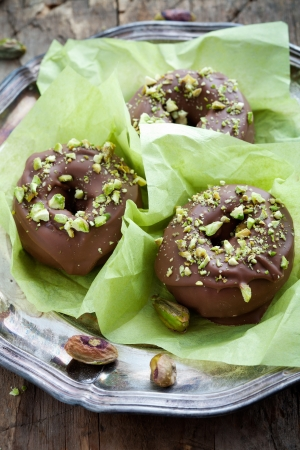Chocolate donuts with crushed pistachios on top Stock Photo - 19015529