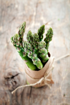 Bunch of fresh asparagus on wooden table Stock Photo