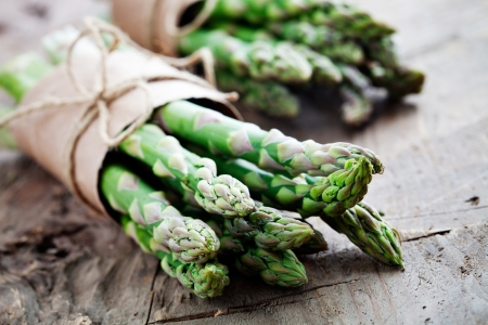 rustic food: Bunch of fresh asparagus on wooden table Stock Photo