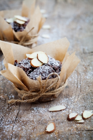 Fresh homemade chocolate muffins with sliced almonds Stock Photo - 19898938