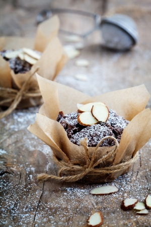 Fresh homemade chocolate muffins with sliced almonds Stock Photo - 19898939