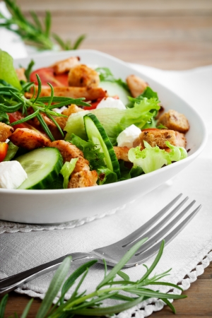 Salad with roasted chicken, tomatoes and feta photo