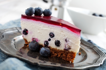 Close up of homemade blueberry cheesecake, selective focus photo