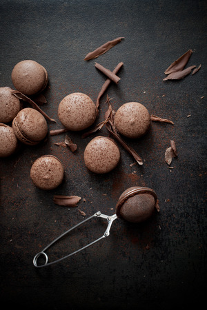 Homemade double chocolate macaroons with chocolate filling photo