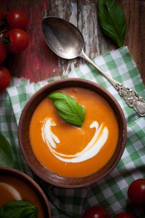 tomato soup: Tomato soup with cream and fresh basil  Stock Photo