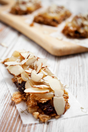 Homemade granola bars with fresh muesli and raisins photo