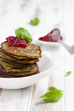 Healthy and delicious spinach pancakes with lingonberry jelly photo