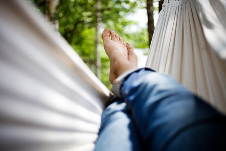 Woman relaxing in hammock