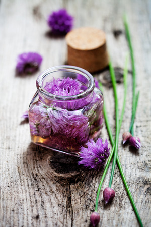 Making chives blossom vinegar from fresh ingredients Stock Photo