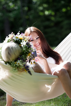 Young woman relaxing in hammock photo