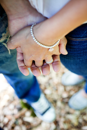 holding close: Young couple just engaged