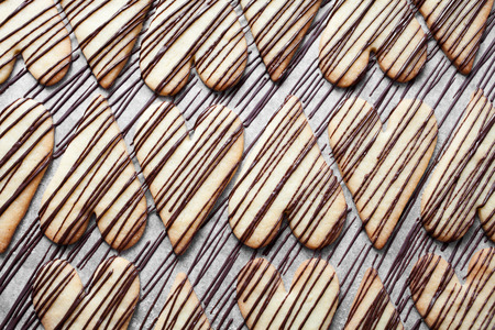 Heart shape cookies with milk chocolate stripes photo