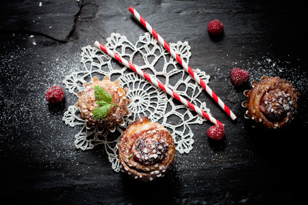 Homemade sweet roll with raspberries and mint
