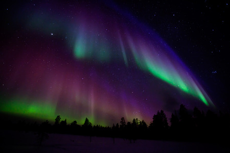 light in dark: Beautiful Northern lights in Lapland of Finland