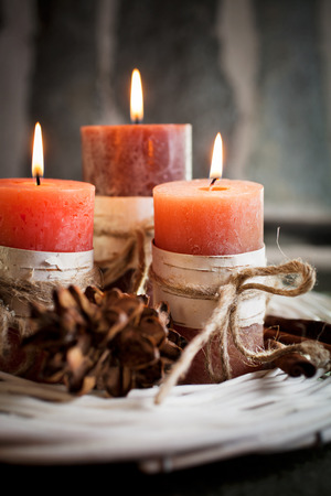 feng: Orange candles with birch decorations