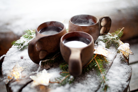 spiced: Mulled wine served from kuksa, specially made wooden cup Stock Photo