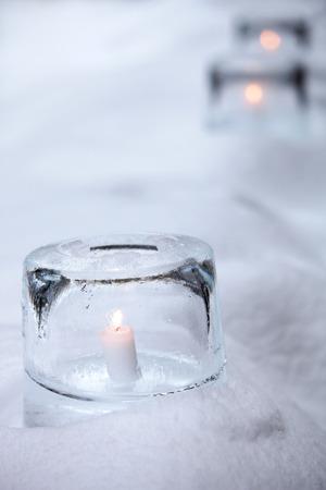 candle light: Ice lantern with white candle burning inside