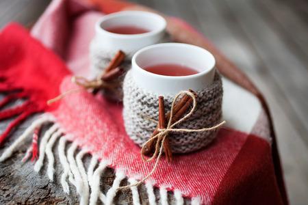 warmer: Mulled wine in mug with mug warmer Stock Photo