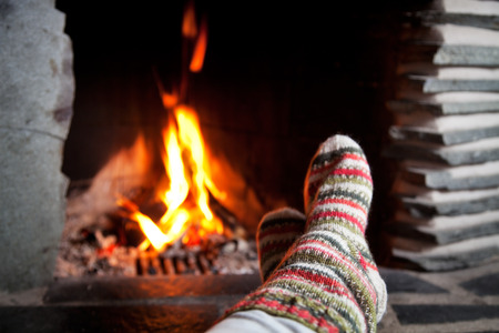 fireplace home: Warming up by the fireplace Stock Photo
