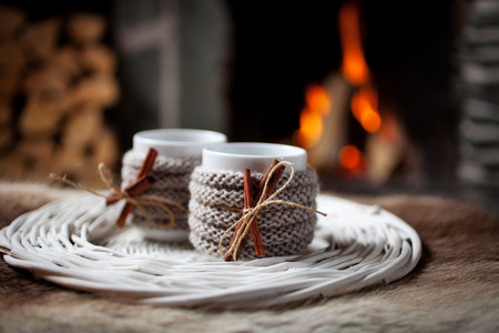 mulled: Mulled wine with cinnamon stick by the fireplace Stock Photo