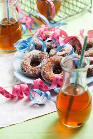 finnish: Finnish traditional Vappu food, sugar donuts with sima