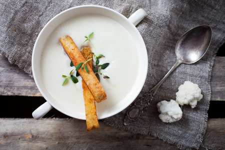 Creamy cauliflower soup with toasted bread Stock Photo