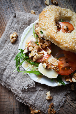 bagel: Homemade bagel filled with goat cheese and tomato