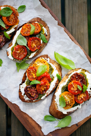Bruschetta with half dried tomatoes and basil Stock fotó