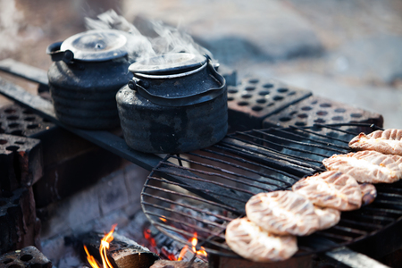 outdoor fireplace: Making coffee by the campfire in forest
