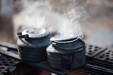 boiling: Making coffee by the campfire in forest