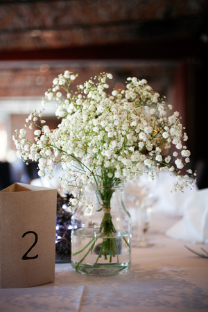 table setting: Wedding table setting with elegant white decoration