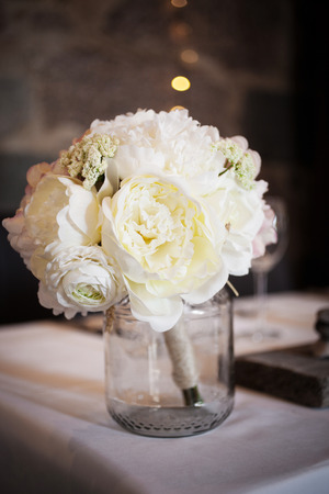 beautiful flowers: Wedding bouquet with white peonies on table Stock Photo