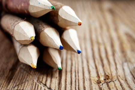tip up: Colourful pencils made of real wood Stock Photo