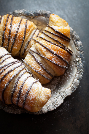 french cuisine: Fresh homemade croissants with chocolate