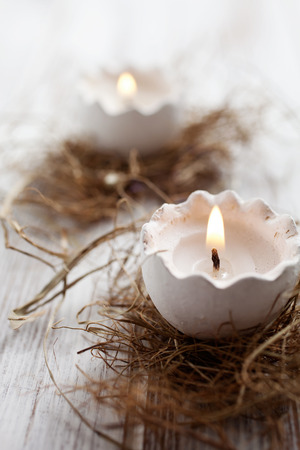 Easter egg shell candles on top of nest