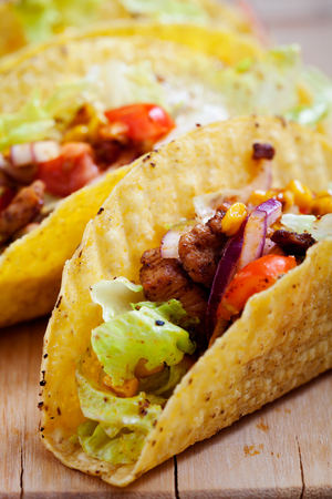 fried food: Fresh Mexican tacos with spicy chicken