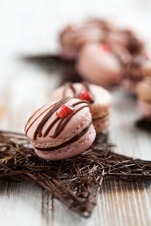 macarons: Pink macarons with chocolate and edible diamond Stock Photo