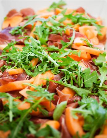 Salad with fresh rucola and cantaloupe Stock Photo