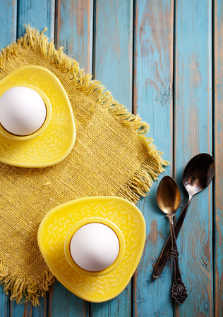 boiled eggs: Boiled eggs served from yellow cups