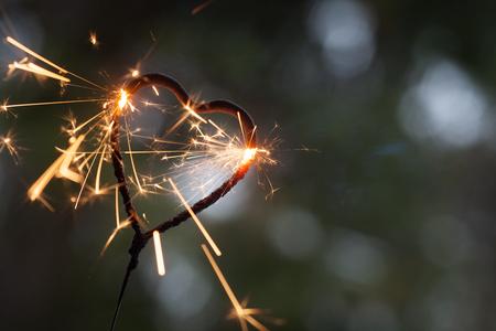 Heart shape sparkler burning in the dark Stock Photo