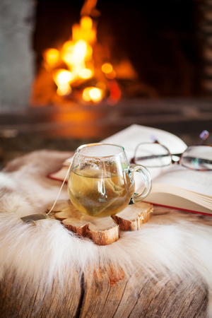Cup of tea by the fireplace Stock Photo