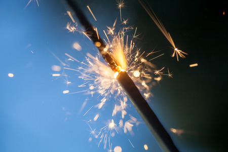 Sparkler burning and glowing in the dark Stock Photo