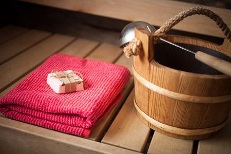 finnish bath: Water bucket, towel and soap in finnish sauna