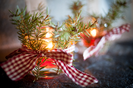 Christmas candles with pine branches and ribbon Stock Photo