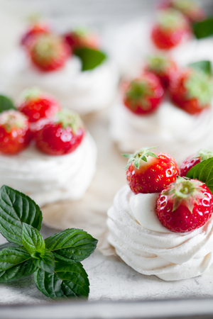 Mini pavlova with strawberries and mint Stock Photo - 80510156